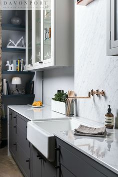 Dark grey cabinets with a light worktop and an accent of copper; modern, striking and magnificent.