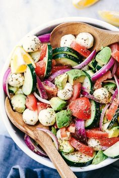 Italian Avocado Cucumber Tomato Salad is a fresh and delicious salad filled with avocado, tomato, red onion, cucumber and mozzarella cheese balls. ...