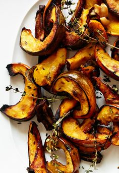 The sweetness of the squash, dates, and coconut oil in this simple, weeknight dinner roasted vegetable dish is balanced by the garlic and woodsy herbs.