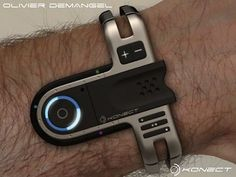 Konect USB watch concept - It sports a Bluetooth radio that acts as a receiver, controls for music playback, a button to answer and end calls, a removable USB stick, and yes it also tells the time.