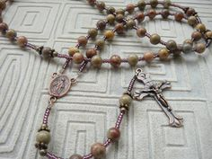 Rosary with stones, copper crucifix and centerpiece, strung on nylon-coated steel flexwire.  https://www.facebook.com/FiorellinoDesigns/photos/a.911990205509195.1073741833.309862172388671/911991202175762/?type=3