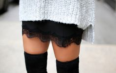 big sweater over sexy skirt and thigh highs..