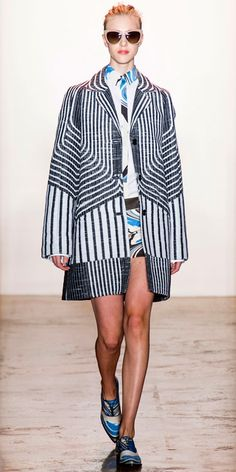 PETER SOM SPRING 2014: Black and white breaker stripe raffia jacquard mackintosh and white cotton poplin shirt paired with a blue wave print cotton sateen short