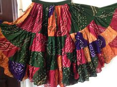 """ATS® American Tribal Style® belly dance 25 yard multi-color bandhani Jaipur multi-tiered skirt. Unique, one of a kind patterns. Double lined in top tier. Drawstring elastic waistband expands up to about 50"""". Skirt length is about 36""""."""