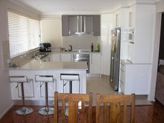G shaped kitchen. So similar to our layout except we have a door on the other side of the fridge.