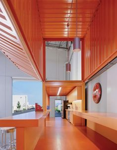 Shipping containers used inside warehouse building: Clive Wilkinson Architects (CWA), Pallotta Teamworks headquarters