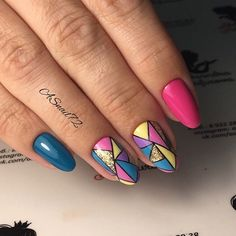 Bold and Classy Geometric Nail Art Design. This bold and classy geometric nail art design is for those girls who love to play with colors.