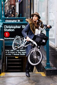 Not sure why she is carrying an unfolded Brompton up the stairs when it would be easier to unfold it up too, but love her look.