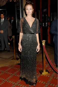 December 2006  Angelina had confirmed her relationship with Brad in January 2006 by announcing her pregnancy. Their daughter Shiloh Nouvel was born in Namibia in May 2006. Seven months later, the actress appeared on the red carpet wearing a sparkling Reem Acra gown for the premiere of The Good Shepherd in New York.