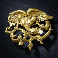 Various themes and motifs were recurrent in Art Nouveau jewelry. Insects as fantasy creatures, especially dragonflies and butterflies, were interpreted in a myriad of ways and mediums. (French Art Nouveau Griffin Brooch. Photo Courtesy of Lang Antiques.)