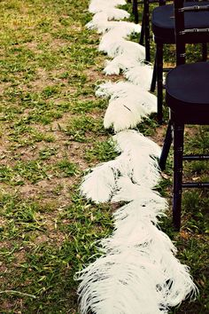 Maybe a trail of feather pedestals to guide guests