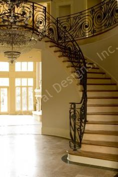 Dazzle your guests when they see the grand staircase of your new Villa Capri House Plan by ArchivalDesigns.com