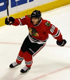 Chicago Blackhawks' Patrick Kane celebrates after scoring his goal against the Minnesota Wild during the third period in Game 1 of an NHL hockey second-round playoff series in Chicago, Friday, May 2, 2014. The Blackhawks won 5-2. (AP Photo/Nam Y. Huh)