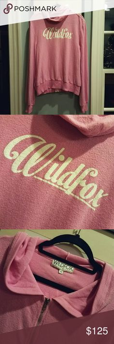 """{Wildfox} 60's Scripted Malibu zip up. One of their best zippys, in my opinion.  The color Romance pink, is a beautiful, dusty bubblegum pink, a limited color that is extremely hard to find.  Flawless condition, never worn or washed. Graphic factory perfect, the slight crackling is part of the design. Soft as new, no signs of wear.  TAGGED MEDIUM, THIS IS A GENEROUS FIT. WORKS FOR SMALL THROUGH LARGE BEST.  MEASURED LENGTH: 26.5""""  BUST: 40"""" FLAT BEFORE STRETCH. Wildfox Tops Sweatshirts…"""
