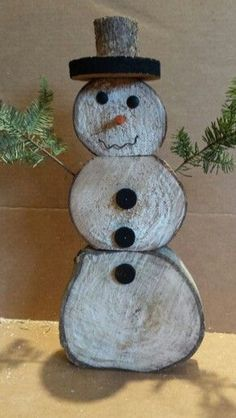DIY Rustic Christmas Decorations snowman-out-of-logs-and-pine-boughs-easy-and-fun-to-make Christmas Wood Crafts, Snowman Crafts, Country Christmas, Outdoor Christmas, Homemade Christmas, Christmas Art, Christmas Projects, All Things Christmas, Winter Christmas