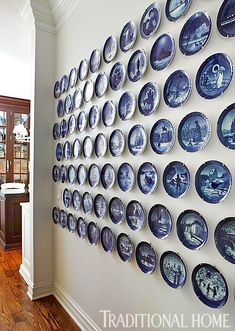 A great collection of Royal Copenhagen blue-and-white plates is displayed in an eye-catching formation. Blue And White China, Blue China, White Plates, Blue Plates, Delft, Traditional Home Magazine, Royal Copenhagen, Christmas Plates, Danish Christmas