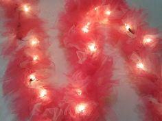 Tulle Christmas Lights, what a cute idea! Added to my list of crafts to make! Maybe not this color though. Diy And Crafts Sewing, Crafts To Make, Crafts For Kids, Diy Crafts, Tulle Garland, Tulle Lights, Red Lights, Fabric Garland, String Lights