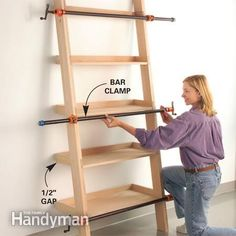 Clamping DIY How to Build a Leaning Wall Shelf great plans on how to build this shelving unit a wall of shelves would be an inexpensive storage