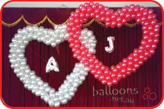 Custom double heart sculpture with Megaloon letters