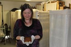 Melissa, in the Robinson House storage area, with our Rebellion Box