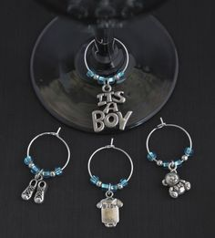 This is an adorable set of baby themed charms for a new baby boy. The charms included in this set are one, IT'S A BOY charm, one set of baby shoes, a baby jumper or onesie, and an adorable 3D teddy bear. Silver lined blue seed beads were used, along with tiny silver accent beads.  Great addition to the wine or water glasses at your baby shower.  Additional charm options are shown in the photo above....more choices to come.