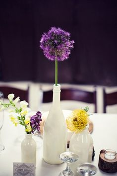 Not the colors, but the concept of 1 flower in a bottle. 25 Ideas for Centerpieces  Wedding Reception Photos on WeddingWire (This is not my image.)