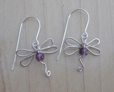 Dragonfly earrings with amethyst. Interesting twists!