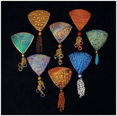 Polymer clay jewelry by Helen Breil.  http://www.helenbreil.com.  Magnificent!