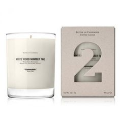 """The scented-soy-wax-candle collection """"White Wood"""" is a series of 3 distinct woodsy scents, with packaging design by Marc Atlan."""