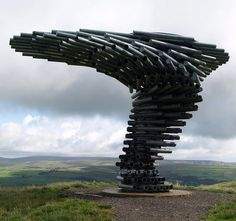 Singing Ringing Tree in Lancashire England is a sculpture made of steel pipes which resonate with the wind and have been tuned by adding holes. Photo by Tony Worrall Foto.