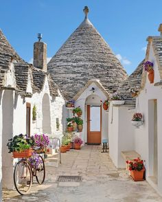 The cute town of Alberobello in Puglia, Italy. Photo by Explore. The Places Youll Go, Places To Go, Destinations D'europe, Alberobello Italy, Beautiful World, Beautiful Places, Wonderful Places, Castel Del Monte, Voyage Europe