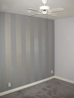 Light grey walls w/ flat finish accented by a metallic silver and flat dark grey striped wall.