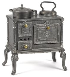 Cast iron toy cook stove, embossed 564, with a cast iron pot and a sad iron, embossed with an anchor, 12'' h., 12'' w.