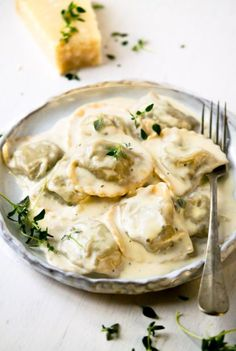 Healthy Dinner Recipes Discover Mushroom Ravioli With Parmesan Cream Sauce Mushroom Ravioli. Homemade ravioli made from scratch and filled with mushroom pate and tossed in a parmesan cream sauce. Serve with a glass of vino. Healthy Dinner Recipes, Gourmet Recipes, Vegetarian Recipes, Cooking Recipes, Italian Food Recipes, Fruit Recipes, Quick Recipes, Healthy Drinks, Parmesan Cream Sauce