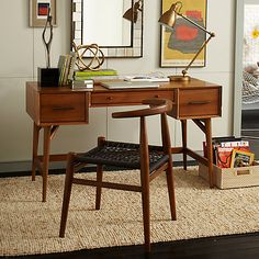 The Mid-Century range by West Elm at John Lewis features bevelled edges, warm colours and bronze-finished hardware emulating the timeless style of 1950s and '60s modernism. Perfect for a little home office!