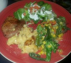 Baked boneless pork , scallop potatoes and steamed vegetables And salad