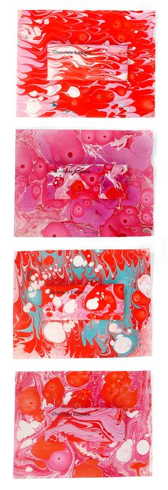 Salted Dark Bar. Each bar is wrapped in its own handmade marbleized paper wrapper – this time is shades of pink's & red's.