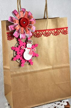 Here's a gift bag I dressed up using the new Made of Snow Mini stamp set and dies, as well as the new Loopsy Daisy dies and the Filigree Border die.    I layered the snowman on a kraft tag that was cut with the tag sale #5 die and I snuck in a raspberry fizz snowflake too!  (Damask Snowflakes die)