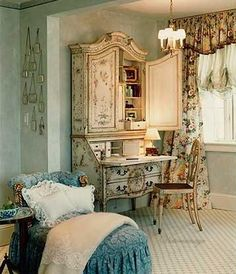 So pretty. Apply paper or fabric to unit with starch.  Roll off excess with roller(as in paint roller) let dry completely and trim excess with a sharp Exacto knife...apply new hardware! If using fabric, make drapes, duvet and pillows to match.