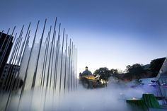 """Cloud Arbor by Ned Kahn, 2012. This public art work consists of 64 stainless steel poles that emit a """"cloud"""" of mist that rises, swirls and falls.  Stroll, run or wander through the poles to have a refreshing and unique experience.  Cloud Arbor is located in Buhl Community Park at Allegheny Square, across from the Children's Museum of Pittsburgh. It was made possible through a gift from the Charity Randall Foundation. Photo by Larry Ripple."""