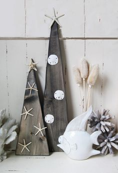 Set of 2 Wood Christmas Trees with Starfish and sand dollars. Looking for coastal christmas decorations, look no further!  #coastal christmas #christmas decorations #christmas tree #coastal #interior design #beach decor #theprojectcottage