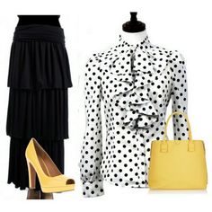 A white,, black & yellow outfit.