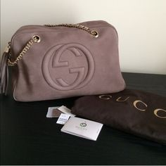 "Gucci Soho Nuback Leather Shoulder Bag Guaranteed Authentic!! Brand new; comes with dust bag and tags as pictures. Take advantage of posh free authentication and promotional free shipping(ask how). Color: Tan/taupe. SOLD NATIONWIDE. Retail tag $1750 plus tax!! ❗️❗️❗️NO TRADES❗️❗️❗️ light fine gold hardware. Natural cotton linen lining. Embossed interlocking G. Double chain shoulder strap with padding 7"" drop. Inside zipper pocket and as well as two others without. Made in Italy . Gucci Bags…"