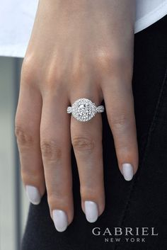 Perfect light and white nails paired with Gabriel NY's 14k white Gold Round double halo engagement ring. Pair the perfect nail color with diamond rings.
