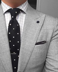 Gray suit, check shirt and polka dot knitted neck tie