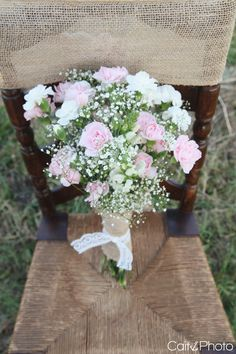 Pastel pink carnations and baby's breath bouquet tied with lace & burlap / hessian. Pretty.