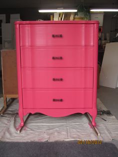 I painted my daughter's white dresser hot pink and added black drawer pulls...LOVE!!
