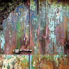 Love the patina found on neglected doors .... they tell a story, have a beauty all of their own.