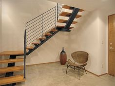Kitchen: Marvellous Staircase Designs For Small Space In Home Interior Modern Wooden Stairs Combine With Innovative Steel Staircase Also Stylish Wicker Chair And Cream Paint Wall Ideas: Agreeable Small Space Decoration Complete with Simple and Nice Staircase