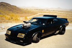 This evil cinematic vehicle emerged off the assembly line in 1974 as the Australian-only make Ford Falcon Coupe XB, but in 1979 it was converted into its true destiny as the Interceptor in the first 'Mad Max' film. Famous Movie Cars, Aussie Muscle Cars, Australian Cars, Ford Falcon, Mad Max, Old Trucks, Fast Cars, Custom Cars, Cool Cars